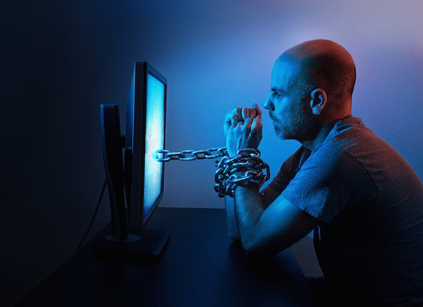 Man chained to computer